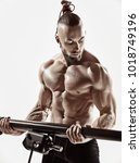 exercise for triceps in the gym.... | Shutterstock . vector #1018749196