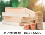 a stack of books and glasses on ... | Shutterstock . vector #1018752202