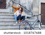 young smiling couple using... | Shutterstock . vector #1018767688