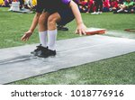 students boy taking long jump... | Shutterstock . vector #1018776916
