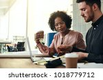 two designers using a laptop... | Shutterstock . vector #1018779712