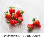 fresh strawberries on plate | Shutterstock . vector #1018780096