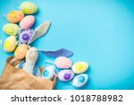 easter bunny in a paper bag... | Shutterstock . vector #1018788982