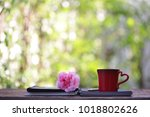 red coffee cup with big pink... | Shutterstock . vector #1018802626