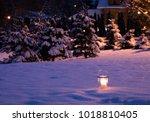 candle in the winter garden | Shutterstock . vector #1018810405