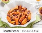 honey glazed baby carrots with... | Shutterstock . vector #1018811512