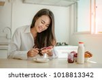 asian woman slicing jam bread... | Shutterstock . vector #1018813342