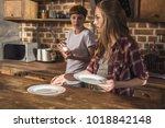 women making table setting for... | Shutterstock . vector #1018842148