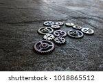 assorted gears on dark textured ... | Shutterstock . vector #1018865512