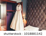 wedding dress hanging on the... | Shutterstock . vector #1018881142