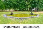 Small photo of PORTO, PORTUGAL - JUNE 4, 2015: Fountain with two allegoric bronze sculptures in Crystal Palace Gardens (Portuguese: Jardins do Palacio de Cristal) of Porto city in Portugal.