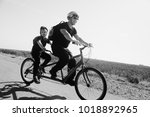 father and son ride a tandem... | Shutterstock . vector #1018892965