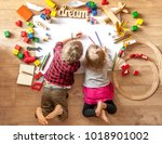 kids drawing on floor on paper. ... | Shutterstock . vector #1018901002