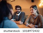 group of students talking in a... | Shutterstock . vector #1018972432