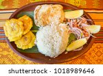 llapingachos are fried potato... | Shutterstock . vector #1018989646
