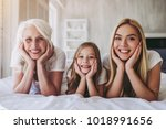 little cute girl  her... | Shutterstock . vector #1018991656