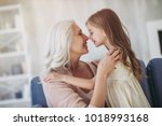 little cute girl and her... | Shutterstock . vector #1018993168