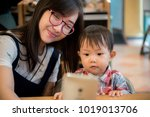 a young asian mother makes... | Shutterstock . vector #1019013706