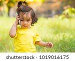 little girl listen and using...   Shutterstock . vector #1019016175