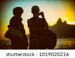 sunset silhouettes of two... | Shutterstock . vector #1019020216