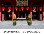 Small photo of Singapore - January 6 2018: The entrance to the famous Buddha Tooth Relic Temple in Chinatown decorated with red lanterns and plants celebrating Chine New Year