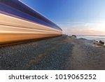 high speed train passing... | Shutterstock . vector #1019065252
