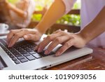 freelance woman's hands on the... | Shutterstock . vector #1019093056