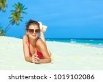 young girl in bright bikini... | Shutterstock . vector #1019102086