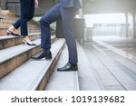 people walking in the street   | Shutterstock . vector #1019139682