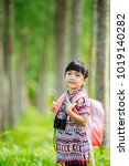 a girl travel in the forest. | Shutterstock . vector #1019140282