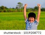 a happy asian boy in casual... | Shutterstock . vector #1019208772
