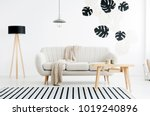 wooden table and lamp near... | Shutterstock . vector #1019240896
