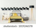 yellow bedsheets on black bed... | Shutterstock . vector #1019246578