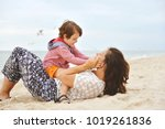 mom with baby playing on the...   Shutterstock . vector #1019261836