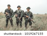 Soldiers Holding Weapon....
