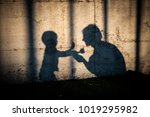 mom and son shadows | Shutterstock . vector #1019295982