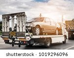 broken car on tow truck after... | Shutterstock . vector #1019296096