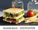 club sandwich pierced with... | Shutterstock . vector #1019314528