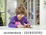 little boy putting coins into... | Shutterstock . vector #1019325352