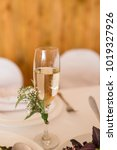 a glass with champagne is... | Shutterstock . vector #1019327926