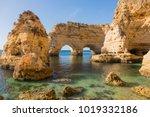 natural caves at marinha beach  ...   Shutterstock . vector #1019332186