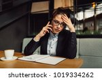 worried businesswoman with... | Shutterstock . vector #1019334262