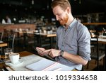 businessman taking notes in cafe | Shutterstock . vector #1019334658
