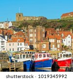 Three Boats Moored In Whitby...