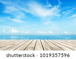 wooden floor with blue sea and... | Shutterstock . vector #1019357596