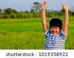 a happy asian boy in casual... | Shutterstock . vector #1019358922