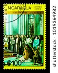 Small photo of MOSCOW, RUSSIA - NOVEMBER 25, 2017: A stamp printed in Nicaragua shows Ferdinand, Isabella, Columbus with crew before throne, serie, circa 1986