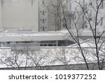 snow in winter on a rooftop.... | Shutterstock . vector #1019377252