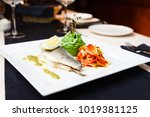 dorada in herbs sauce with... | Shutterstock . vector #1019381125