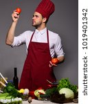 man with beard holds tomatoes... | Shutterstock . vector #1019401342
